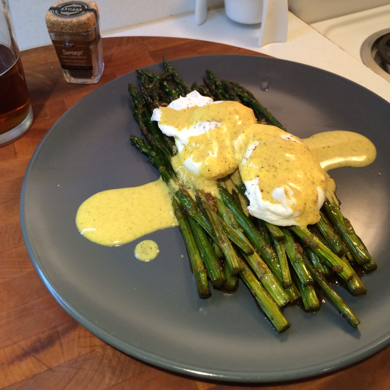 Poached eggs atop hickory glazed asparagus, with a curried yogurt sauce